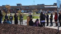 Students, staff and community members at the dandelion dedication