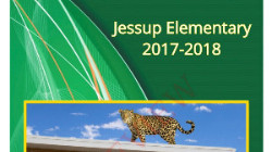 Jessup Elementary 2017-2018 Yearbook cover with a jaguar on the roof of school