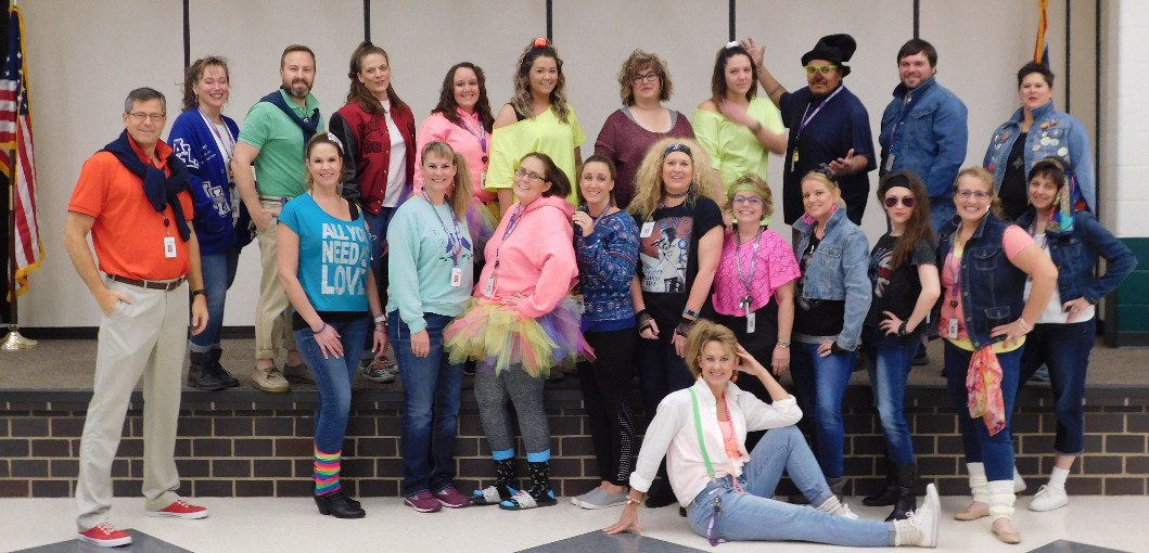 Staff dressed in 80's attire