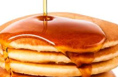 Picture of syrup pouring onto pancakes
