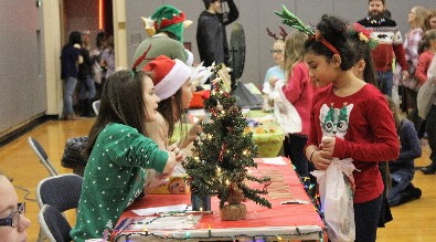 Hickory Grove students shop during the annual Wheelers and Dealers event at Brookville High School.