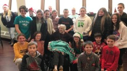 6th graders visiting residents at Jefferson Manor.