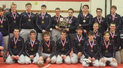 Brookville Raider wrestling team wearing D9 medals.