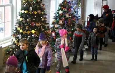 Students walking through Christmas Tree Lane.