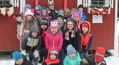 Kindergarteners at the Santa house outside of the courthouse