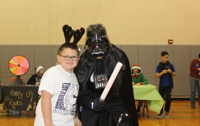A Hickory Grove student poses with Darth Vader at Wheelers and Dealers.