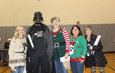 Hickory Grove teachers pose with Darth Vader at Wheelers and Dealers.