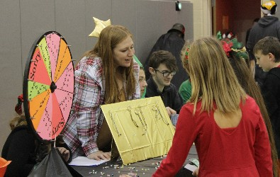 Economics students interact with Hickory Grove student shoppers during Wheelers and Dealers.
