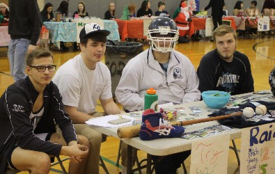 Economics students pose at their table during Wheelers and Dealers.