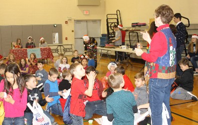 Hickory Grove students receive instructions from their teacher prior to shopping at Wheelers and Dealers.