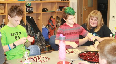 Sixth graders work on nature crafts.