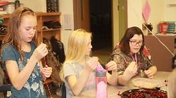 Sixth graders making cranberry garland.