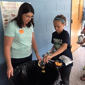People collecting food scraps for composting.