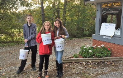 Students collecting donations at free family movie night.