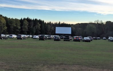 Cars filling into the field at free family movie night.