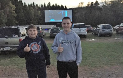 Two students at free family movie night.