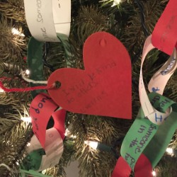 """Heart ornament and chain decorations on """"Chain Reaction to Kindness"""" tree."""