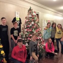 """BASD Students with """"Chain Reaction to Kindness"""" tree at Christmas Tree Lane."""