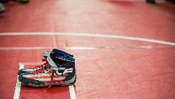 Image of wrestling shoes on mat