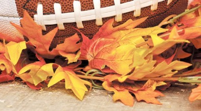 Image of football and fall leaves