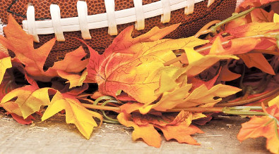 Image of fall leaves and a football