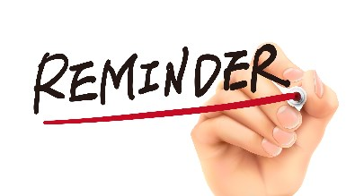 "Image of a hand writing the word ""Reminder"""