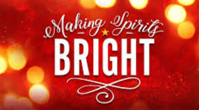 """Soft image of white christmas lights with the words """"Making Spirits Bright."""""""