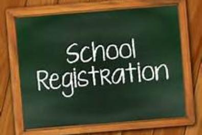 sign reads school registration