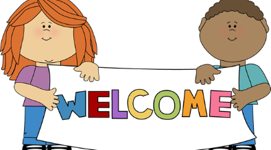 """Image of two children holding a sign that says """"Welcome"""""""