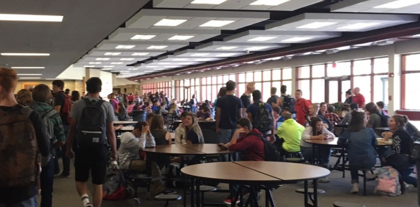 Picture of students at lunch time. Caption says, Lunch time at Central High School.