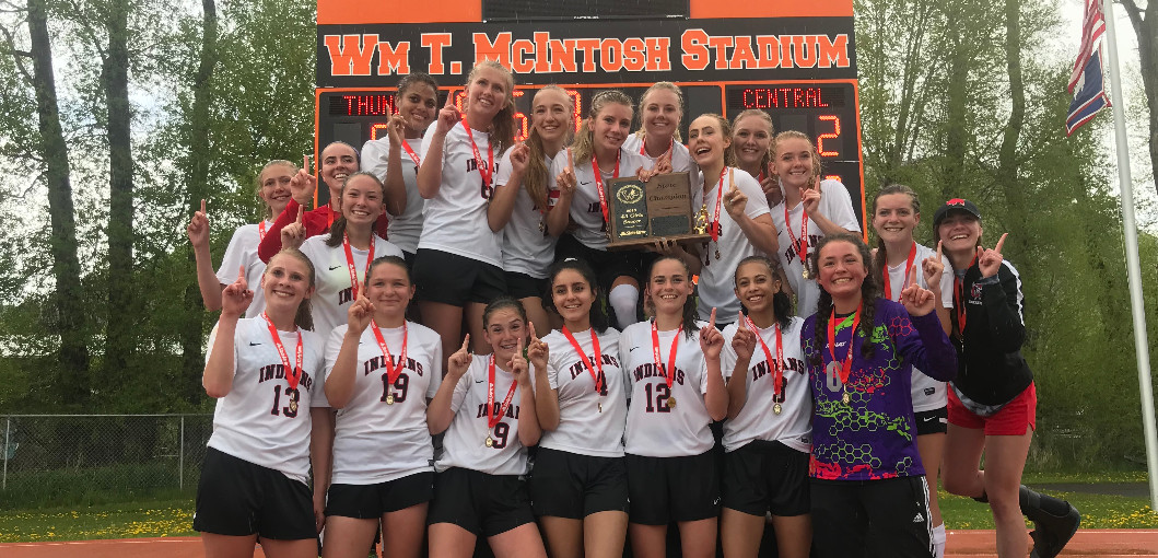 This is a picture of the ladies soccer team with the State title.