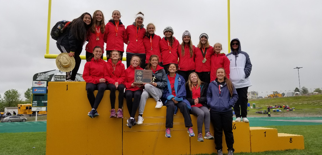 This is a picture of the Girls track team with the state title.