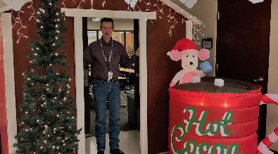This is a picture of Mr. Berry and his winnin Christmas door.