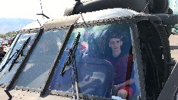 student sitting inside helicopter