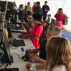 students operating equipment at air show