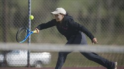 Nelson tennis team's No. 2-seeded singles player Destinee Glover returns the ball while on the run.