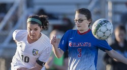 Grace Clair battles Dan River player for ball control.