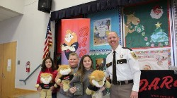 TRES students accepting DARE lions.