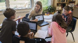 Hayley Osborne works with her 4th grade students at Rockfish River Elementary School.