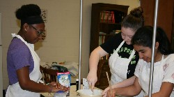 Chenté Wallace, Destiny Tyree and Ruby Galvez-Sanchez work on their original recipe, Horchata Fudge Candy.