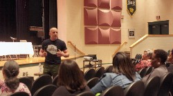 Kevin Hines addresses high school students about mental health issues.