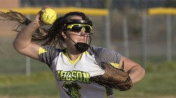 Madi Martin fires to first base.