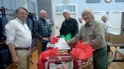 Rotary Club of Nelson County prepare gift bags for Nelson High School students.