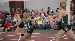 Raelyn McGarry hands off to Treshanda Crawford in relay action.
