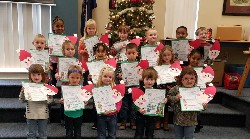 Tye River students holding up their Santa wish lists.