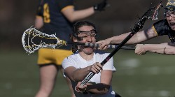 Sweet Briar College's Victoria Lawson takes a stick to the face in a battle with Averett University.