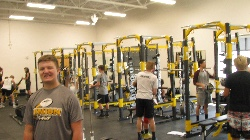 Students utilizing the new state of the art weight training room