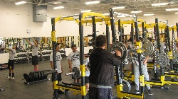 Students utilizing the new state of the art equipment in the weight room