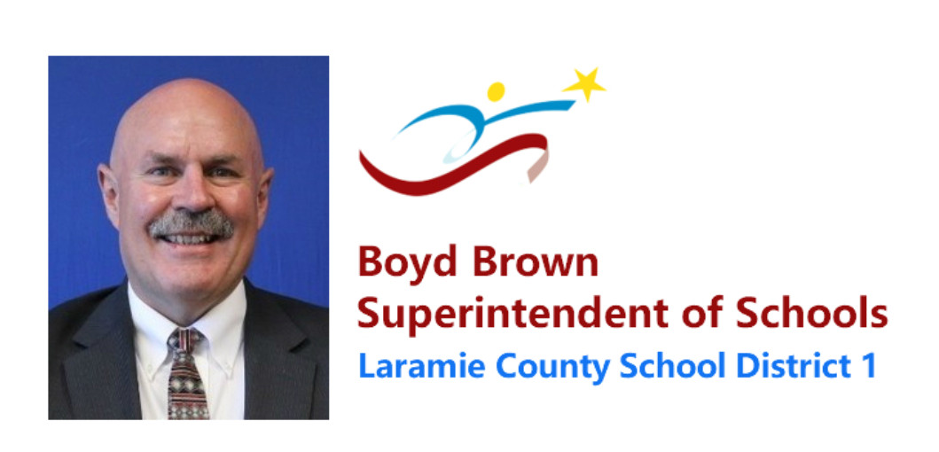 DIstrict logo with photo of superintendent