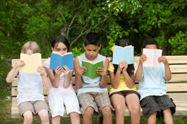 picture of kids on bench reading